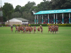 Tribal dancers performing in front of the packed stadium
