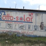Advert for solar products painted on side of building.