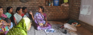 A Community Resource Person (CRP) in Bihar, India, disseminating a video to women's self help groups